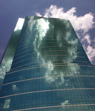 Glass & Sky 1. Tall glass fronted building reflecting clouds and sky royalty free stock photos