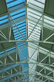 Glass skylight roof. At airport showing blue sky with green ceiling and steel girders Royalty Free Stock Photos