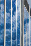 Glass skyscraper against blue sky Stock Images