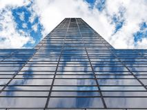 Glass Skyscraper cloudy sky. Glass or Windows Skyscraper cloudy sky Royalty Free Stock Images