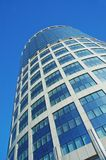 Glass skyscraper over blue sky Stock Photography