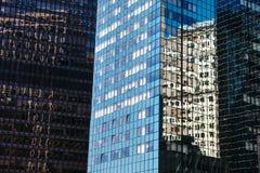 Glass skyscraper reflecting the blue sky in Manhattan stock photos