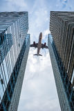 Glass skyscrapers with the airplane Stock Images