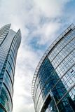 Glass skyscrapers of irregular shape. Bottom view. Abstract architectural detail of corporate building suitable as background. Abstract architectural detail of royalty free stock photo