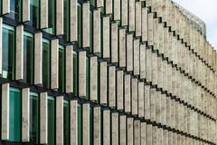 Glass skyscrapers of irregular shape. Bottom view. Abstract architectural detail of corporate building suitable as background. Abstract architectural detail of royalty free stock photography