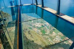 Glass skywalk Mirador de Abrante with view to village Agulo, Atlantic ocean and Teide in Tenerife, April 24, 2015, Gomera, Spain royalty free stock photos