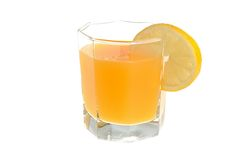 Glass with a slice of lemon filled with citrus juice isolated Royalty Free Stock Image