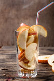 Glass with slices of apples Royalty Free Stock Images