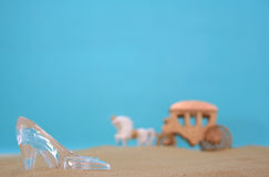 Glass Slipper. On Beach With Carriage in Background Royalty Free Stock Image