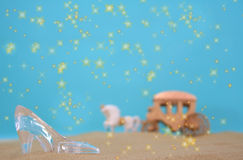 Glass Slipper. On Beach With Carriage in Background Stock Images
