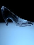 Glass Slipper. An illuminated glass slipper in cool blue tones Royalty Free Stock Photography