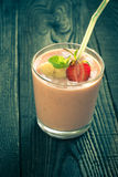 Glass of smoothie with strawberries Royalty Free Stock Photos