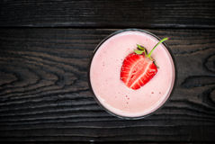 Glass of smoothie with strawberries Stock Image
