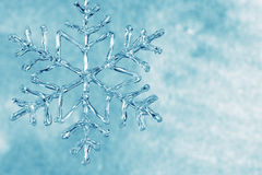 Glass snowflake. Background with blue glass snowflake Stock Images