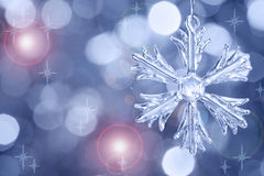 Glass snowflake against blurred background Stock Images