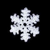 Glass snowflake on black Royalty Free Stock Images