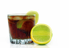Glass of soda with ice cubes and lime, whiskey cola Stock Photography
