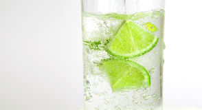 Glass of soda. With lime on white background, low aperture Royalty Free Stock Image