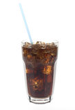 Glass of soda with straw. Glass of dark cola soda with a straw against white Stock Image