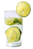 Glass of soda water with cut limes. Glass of soda water with sliced limes in it Stock Image