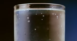 Glass of soda water. Fizzy bubbles rising. stock video