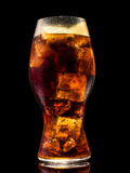 Glass of soda water with ice cubes over black background Royalty Free Stock Images
