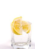 Glass with soda water and lemon Stock Images