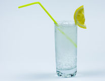 Glass with soda. A glass with soda water and lemon on a white background Royalty Free Stock Photos