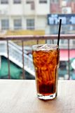 Glass of soft drink with ice on the table Royalty Free Stock Images