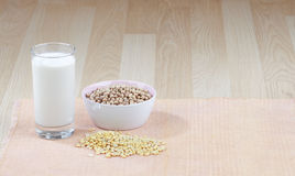 Glass of soy milk and raw soybean Stock Photos