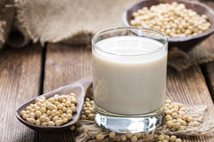 Glass with Soy Milk. And Seeds on wooden background Royalty Free Stock Photo
