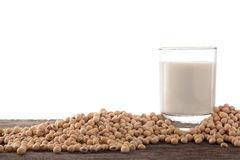 Glass of soy milk and soy bean on wood background. Stock Images