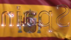 Rotating glass Spain caption against waving Spanish flag stock footage
