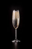 Glass of sparkling champagne on black background Stock Images