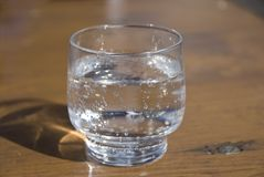 Glass of sparkling mineral water. Royalty Free Stock Image