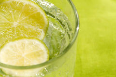 Glass of sparkling water and lemon. Refreshment for background Royalty Free Stock Image