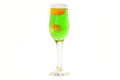 A glass of sparkling water and slices of Mandarin. Sparkling water Tarhun. Stock Photos
