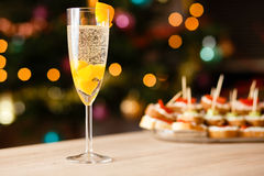 A glass of sparkling wine with apricot. On the table Stock Photo