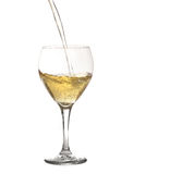 Glass of Sparkling Wine or Champagne Being Poured Stock Photography