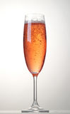 Glass of sparkling wine. Glass of pink sparkling wine stock photos