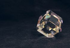 Glass spectrum. Spectrum rainbow in the glass polyhedron on the black backgraund stock photos