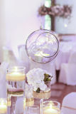 Glass sphere with candle inside. Wedding decoration. Stock Image
