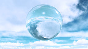 Glass sphere in clouds Royalty Free Stock Image