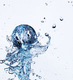 Glass sphere fall in water Stock Images