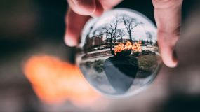 Glass Sphere in Hand royalty free stock photo