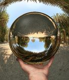 Glass sphere in hand. Vai. Crete Stock Images