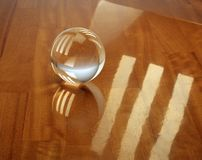 Glass sphere on an oak parquet Stock Images