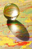 Glass Sphere On Painting royalty free stock photo