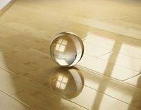 Glass sphere on a parquet from a bamboo Stock Images