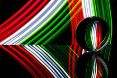 Glass sphere reflecting colorful light Royalty Free Stock Image